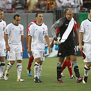 Members of the United States mens team walk onto the pitch prior to a CONCACAF Gold Cup soccer match between the United States and Panama on Saturday, June 11, 2011, at Raymond James Stadium in Tampa, Fla. (AP Photo/Alex Menendez)