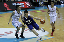 QUEZON Quezon City, May 14, 2017  Miguel Tan of the Philippines (C) competes against David Macaraig Chuabio (L) and Reuben David Amado (R) of Singapore during their match in the 2017 SEABA junior men's championship tournament in Quezon City, the Philippines, May 14, 2017. The Philippines won, 108-42.  2017?5?14? (Credit Image: © Rouelle Umali/Xinhua via ZUMA Wire)