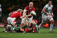 Martyn Williams of Wales passes the ball. Invesco perpetual series, Wales v Argentina at the Millennium Stadium in Cardiff on Sat 21st Nov 2009. pic by Andrew Orchard, Andrew Orchard sports photography,