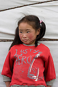 young girl leaning on the ger, Mongolia