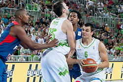 Mirza Begic and Jure Balazic of Slovenia during last friendly match before Eurobasket 2013 between National teams of Slovenia and France on August 31, 2013 in SRC Stozice, Ljubljana, Slovenia. (Photo by Urban Urbanc / Sportida.com)