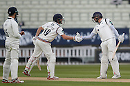 Yorkshire Gary Ballance  congratulates Yorkshire Jack Leaning on his unbeaten 50 during the Specsavers County Champ Div 1 match between Warwickshire County Cricket Club and Yorkshire County Cricket Club at Edgbaston, Birmingham, United Kingdom on 24 April 2016. Photo by Simon Davies.