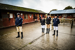 Staff and Royal Navy personnel stand silent at the Royal Navy and Royal Marines Riding Stables at Bickleigh Barracks, Plymouth, during the first ever memorial service dedicated to horses killed or injured in conflict.