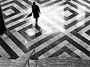 businessman crossing marble hall