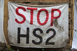Wendover, UK. 9th April, 2021. A Stop HS2 banner hangs from the exterior of Wendover Active Resistance Camp, which is occupied by activists opposed to the HS2 high-speed rail link. Tree felling work for the project is now taking place at several locations between Great Missenden and Wendover in the Chilterns AONB, including opposite the camp.