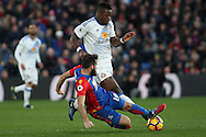 Joe Ledley of Crystal Palace (L) tackles Lamine Kone of Sunderland (R). Premier League match, Crystal Palace v Sunderland at Selhurst Park in London on Saturday 4th February 2017. pic by Steffan Bowen, Andrew Orchard sports photography.