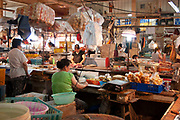 Meat and tofu and other goods for sale at a wet market on Renmin Lu in Shanghai, China. These amazing markets sell anything from fish to meat, vegetables, to live poultry. Tucked away all over the city these wet markets are where most Shanghainese do their food shopping.