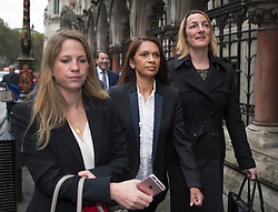 © Licensed to London News Pictures. 13/10/2016. London, UK. Gina Miller (C) arrives at the High Court. Ms Miller and other campaigners are launching a legal challenge, after the EU referendum result, to force the government to seek Parliamentary approval before Brexit negotiations begin. Photo credit: Peter Macdiarmid/LNP