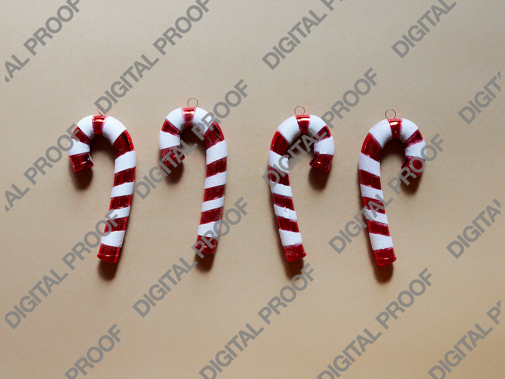 Christmas candy cane drums  at studio above view over a brown cream background isolated flatlay