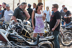 Anita and Peter Penzenstadler check out the great bikes on display at Harley Davidson's Editor's Choice Bike Show at the Broken Spoke Saloon during Daytona Bike Week 75th Anniversary event. FL, USA. Wednesday March 9, 2016.  Photography ©2016 Michael Lichter.
