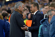 José Mourinho, the Chelsea Manager and Slavisa Jokanovic, the Maccabi Tel Aviv manager talk to each other in the dugout before k/o. UEFA Champions League group G match, Chelsea v Maccabi Tel Aviv at Stamford Bridge in London on Wednesday 16th September 2015.<br /> pic by John Patrick Fletcher, Andrew Orchard sports photography.