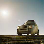Low angle view of 4x4 in the Sahara, Libya