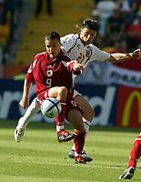 Fotball, Alveira Portugal, EM, Euro 2004, 150604, Tsjekkia - Latvia ,<br /> MARIS VERPAKOVSKIS (LATVIA)<br /> TOMAS UJFALUSI (CZECH REPUBLIC)<br /> Photo Roger Parker ,Digitalsport