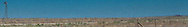 windmill in rural New Mexico USA panorama
