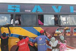 Venders Offering Food To Travelers