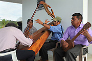 A music group that includes Justino Peck (right), former TCGA chairman, performs during the 2013 Annual General Meeting. Toledo Cacao Growers' Association (TCGA), Julian Cho Technical High School, Mile 14 Southern Highway, Toledo, Belize. January 26, 2013.