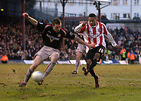 Photo: Daniel Hambury.<br />Brentford v Sunderland. The FA Cup. 28/01/2006.<br />Brentford's Dudley Campbell (R) scores his second goal to win the game.