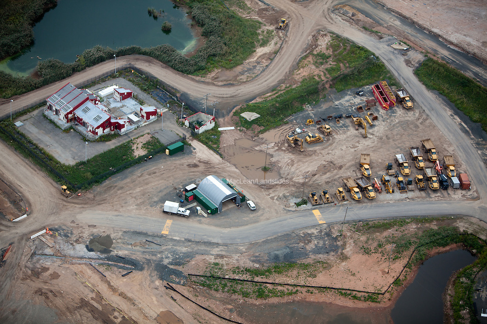 Construction trucks on the edge of Fresh Kills Landfill during its conversion in to a park