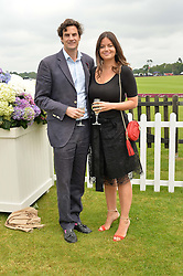RUPERT & LADY NATASHA FINCH at the Cartier Queen's Cup Polo final at Guard's Polo Club, Smiths Lawn, Windsor Great Park, Egham, Surrey on 14th June 2015