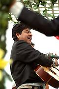Musician age 38 performing at the Cinco de Mayo festival.  St Paul Minnesota USA
