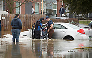 Sarah Poorman looks on as emergency personnel rescue a stranded motorist with parkinson at Parkview Apartments.