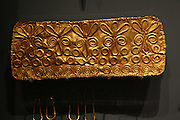 Bronze dirk (dagger) blade, upper part of the midrib decorated with a herringbone pattern, 1800-1600 BC.  Clay model of a Red Polished dagger and sheath, 2100-2000 BC.  Gold funerary frontlet (diadem) embossed spirals, circles and flowers, 1450-1200 BC, probably from Enkomi.  Two gold fibulas and a finger ring, from Kouklia - Palaepaphos, tomb 2, 1200-1050 BC.