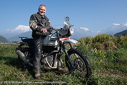 Kelly Modlin poses with a spectacular background of 23,000' peaks on day-4 our our Himalayan Heroes adventure riding from Pokhara to Kalopani, Nepal. Friday, November 9, 2018. Photography ©2018 Michael Lichter.