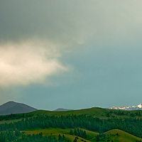 Montana's Spanish Peaks rise behind the Story Hills near Bozeman.