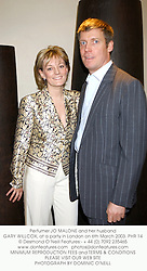 Perfumer JO MALONE and her husband GARY WILLCOX, at a party in London on 6th March 2003.PHR 14