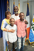 September 19, 2012- Queens, New York:  Former Prisoner Tamsir Jasseh and family pose for photograph as a free man after being held as a prisoner in the Gambia, West Africa. Former Prisoner Amadou Scattred Janneh, a former Professor at the University of Tennessee, who held dual US Citizenship with the Gambia, was serving a life sentence for Treason. In addition to him, Tamsir Jessah, a U.S Citizen and former U.S. Military Veteran with dual citizenship with the West African nation was also serving a twenty-year sentence for Treason. With a face-to-face appeal by Rev. Jesse L. Jackson, with the Yayha Jammeh, President of The Gambia an agreement was made to release the two American citizens into Rev. Jackson's custody who allow them to return to the United States with Jackson Tuesday night.  The two men returned to the U.S. by plane with Rev. Jackson from The Gambia to joyfully grateful waiting family members. In addition, President Jammeh has agreed to extend the moritorium on executions indefinitely, marking a significant gain for Human Rights in the West African Nation on September 19, 2012. (Terrence Jennings)