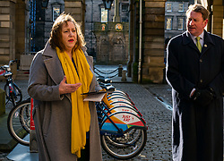 City Chambers, Edinburgh, Scotland, United Kingdom, Just Eat E-bikes: A new fleet of 163 rentable e-bikes are launched and integrated into the capital's existing cycle hire scheme by Just Eat Cycles. Edinburgh will now have the largest docked e-bike fleet in UK. Pictured: Councillor Lesley McInnes, Transport and environment convener, launches the e-bike scheme with George Lowder, Chief Executive of Transport for Edinburgh.<br /> Sally Anderson | EdinburghElitemedia.co.uk