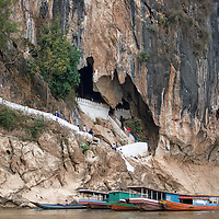 The lower Pak Ou caves, seen from the Mekong river. The caves are famous for containing hundreds of buddha statues.