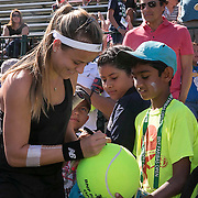 March 7, 2015, Indian Wells, California:<br /> Nicole Gibbs signs autographs during Kids Day at the Indian Wells Tennis Garden in Indian Wells, California Saturday, March 7, 2015.<br /> (Photo by Billie Weiss/BNP Paribas Open)