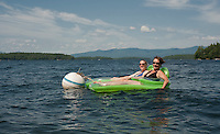 """No Place That I'd Rather Be""...   for Cathy Cram and her niece visiting from Massachusetts as they enjoy lounging in Lake Winnipesaukee on Friday afternoon.  (Karen Bobotas/for the Laconia Daily Sun)"
