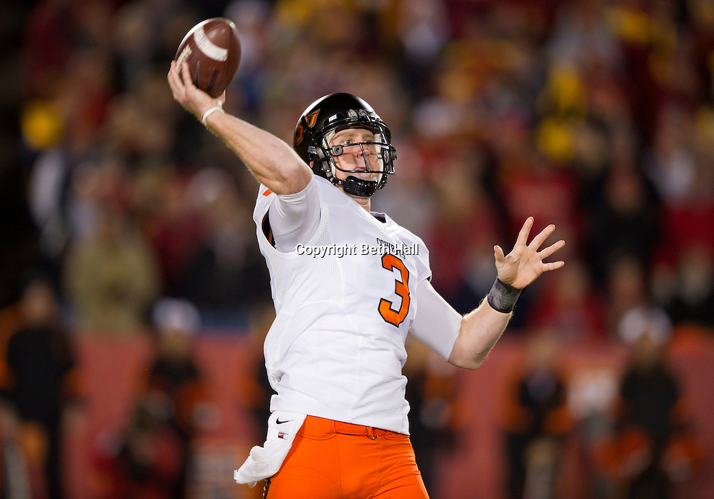 Nov 18, 2011; Ames, IA, USA; Oklahoma State Cowboys quarterback Brandon Weeden (3) makes a throw during the second half of a game against the Iowa State Cyclones at Jack Trice Stadium. Iowa State defeated Oklahoma State 37-31.  Mandatory Credit: Beth Hall-US PRESSWIRE Editorial sports photography of the Iowa State Cyclones vs. Oklahoma State Cowboys in 2011 in Aimes, Iowa.