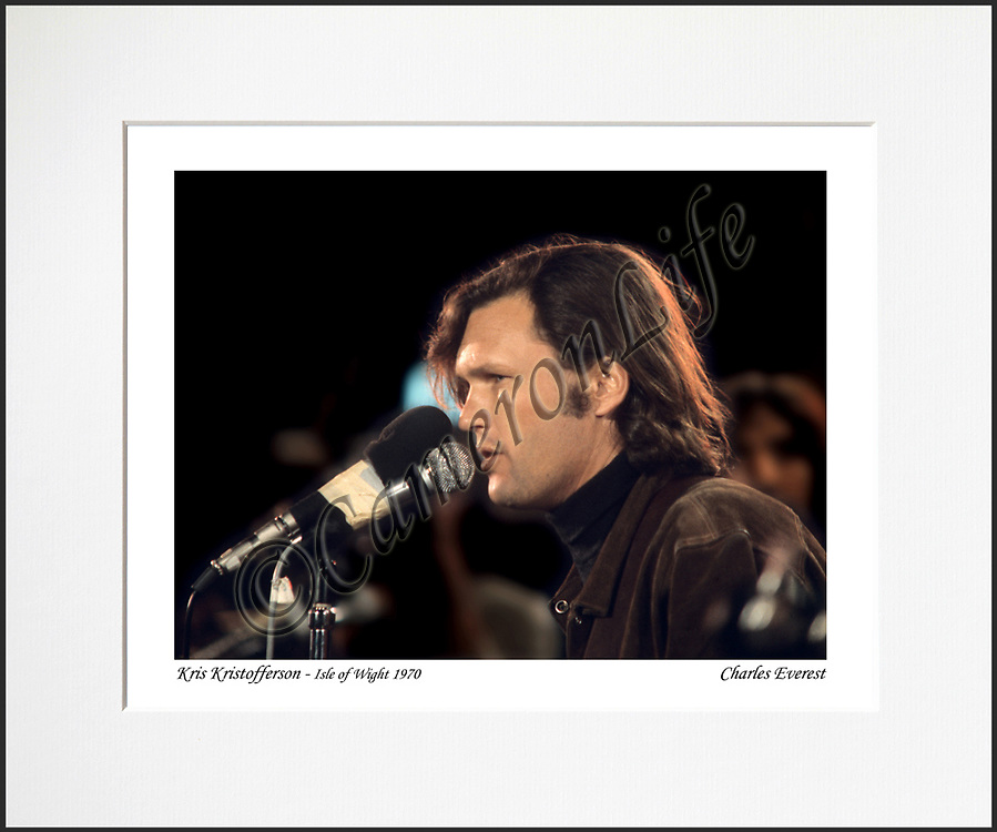 """Kris Kristofferson - An affordable archival quality matted print ready for framing at home.<br /> Ideal as a gift or for collectors to cherish, printed on Fuji Crystal Archive photographic paper set in a neutral mat (all mounting materials are acid free conservation grade). <br /> The image (approx 6""""x8"""") sits within a titled border. The outer dimensions of the mat are approx 10""""x12""""."""