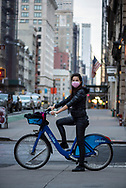 Valentina, from Italy but living in New York City, pauses at a stop light during a ride through the unusually empty streets on account of the Covid-19 pandemic. <br /> <br /> (March 20, 2020)