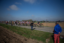 The peloton rides on the Lange Munte, the first cobbled section of the Ronde Van Vlaanderen - a 153.2 km road race, starting and finishing in Oudenaarde on April 2, 2017, in East Flanders, Belgium.