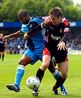 Photo: Alan Crowhurst.<br />Wycombe Wanderers v Lincoln City. Coca Cola League 2. 23/09/2006. Jermaine Easter of Wycombe (L) challenges with Paul Morgan.