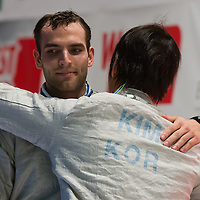 Aron Szilagyi (L) of Hungary granulates to the winning Kim Junghwan (R) of Korea after their fight during the final of the Gerevich-Kovacs-Karpati Men's Sabre Grand Prix in Budapest, Hungary on March 09, 2014. ATTILA VOLGYI