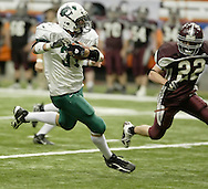 Cornwall's Matt Moretto, left, carries the ball as Brad Comfort of Corning East defends during the Class A state championship game at the Carrier Dome in Syracuse on Nov. 24, 2006.