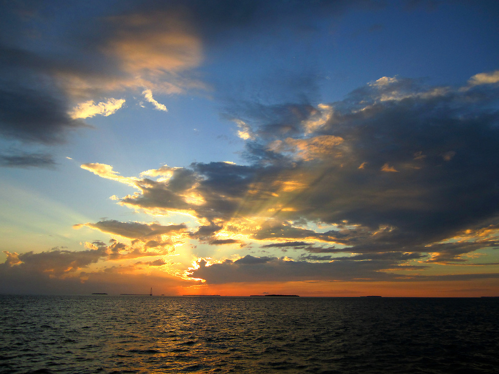 Sun's dying rays break through clouds off Key West Florida