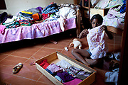 A young girl packs up her things in anticipation of an eviction. Isidoro occupation in Belo Horizonte, Minas Gerais in a large  amount of land that was occupied by the MLB, a Brazilian workers social movement, it faced eviction in July / August 2014. (photo by Phil Clarke Hill/In Pictures via Getty Images)