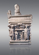 """End panel of a Roman relief sculpted sarcophagus with kline couch lid with a reclining male figuer depicted, """"Columned Sarcophagi of Asia Minor"""" style typical of Sidamara, 3rd Century AD, Konya Archaeological Museum, Turkey. Against a grey background .<br /> <br /> If you prefer to buy from our ALAMY STOCK LIBRARY page at https://www.alamy.com/portfolio/paul-williams-funkystock/greco-roman-sculptures.html . Type -    Konya     - into LOWER SEARCH WITHIN GALLERY box - Refine search by adding a subject, place, background colour, museum etc.<br /> <br /> Visit our ROMAN WORLD PHOTO COLLECTIONS for more photos to download or buy as wall art prints https://funkystock.photoshelter.com/gallery-collection/The-Romans-Art-Artefacts-Antiquities-Historic-Sites-Pictures-Images/C0000r2uLJJo9_s0"""
