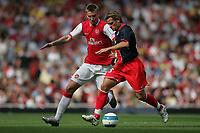 Photo: Lee Earle.<br /> Arsenal v Paris Saint-Germain. The Emirates Cup. 28/07/2007.Arsenal's Nicklas Bendtner (L) battles with Jerome Rothen.