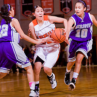020513       Cable Hoover<br /> <br /> Gallup Bengal Shanel Begay (23) pushes between Miyamura Patriots Danielle Chee (10) and Raquel Spencer (22) Tuesday at Gallup High School.