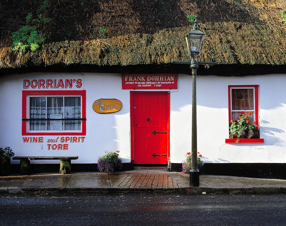 Morning rain has washed the sidewalk at Dorrian's Pub in Ballyshannon, Co. Donegal, Ireland.