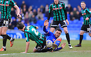 Aaron Amadi-Holloway tackled by Joe Rafferty during the Sky Bet League 1 match between Oldham Athletic and Rochdale at Boundary Park, Oldham, England on 19 March 2016. Photo by Daniel Youngs.
