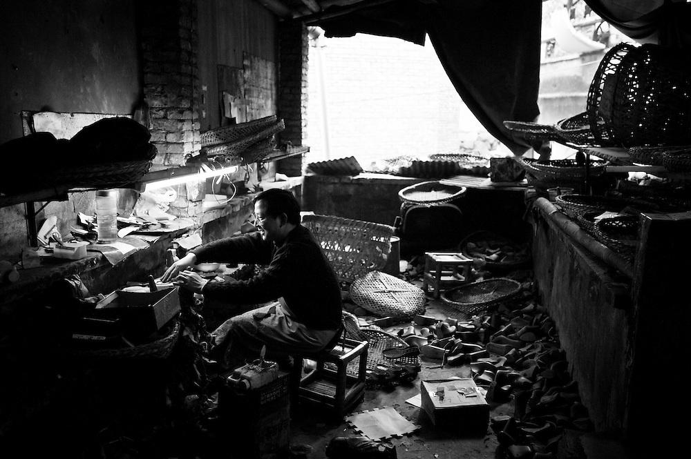 CHONGQING, CHINA - DECEMBER 31, 2010:  worker in a shoe factory