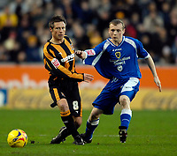 Photo: Jed Wee.<br />Hull City v Cardiff City. Coca Cola Championship. 16/12/2006.<br /><br />Hull's Nick Barmby (L) and Cardiff's Willo Flood fight for possession.